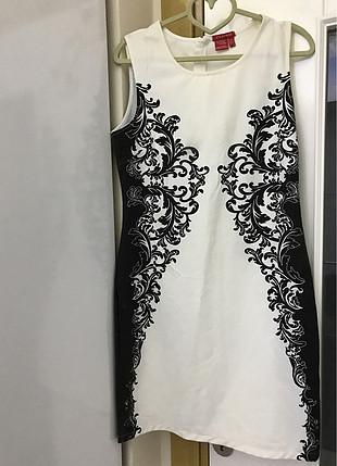 Zayıf gösteren kalem elbise
