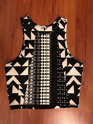 Sıfır kollu siyah beyaz bluz
