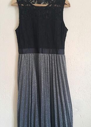 Eteği fileli ve simli midi boy üstü tül elbise