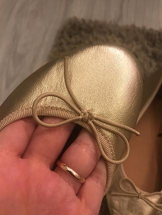 H&M babet gold renk