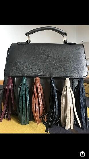 Her kıyafete uygun gri renkli çanta