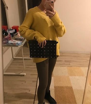 Siyah zımbalı el çantası