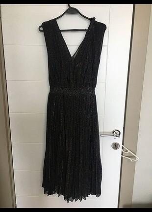 İpekyol astarlı simli elbise