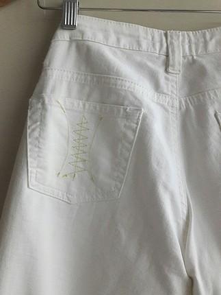 Tasarımcı butik ürünü ic göstermeyen beyaz kapri