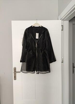 Delik astarlı ceket iç gosterir