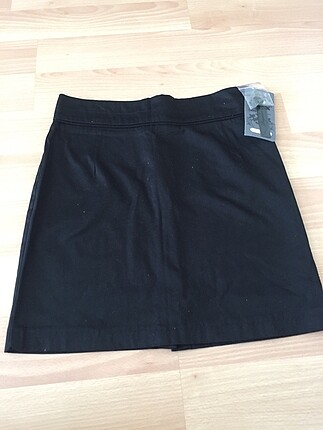 Siyah kumaş etek