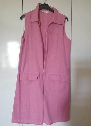 Hic giyilmemis elbise kilo aldigim icin satiyorum