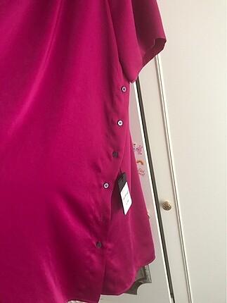 40 Beden Fuşya renk 40 beden harika bir gömlek/ elbisedir.