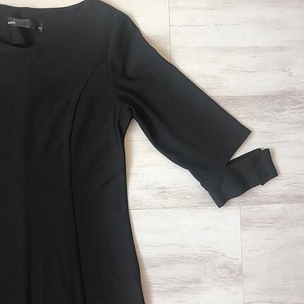 Hiç kullanılmamış sıfır kumaş elbise