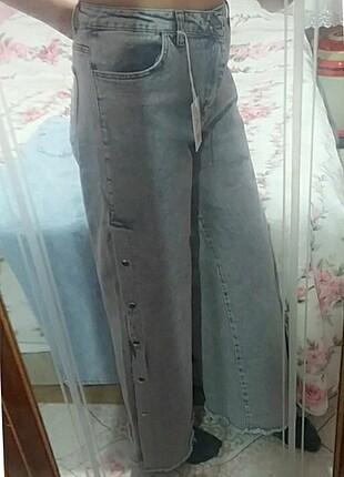 Kot pantolon çıtçıtlı püsküllü