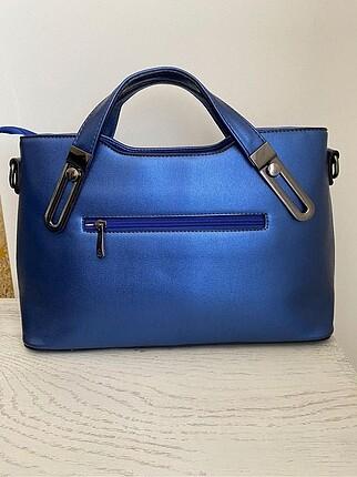 Matthew cox Saks mavi el çantası