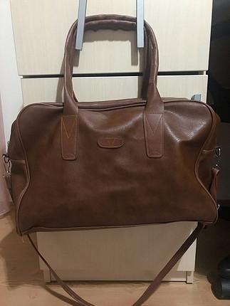 Yepyeni,el çantası olarak da(uçak) kullanılabilir geniştir.