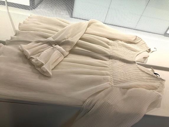 Pileli ve volanlı bluz